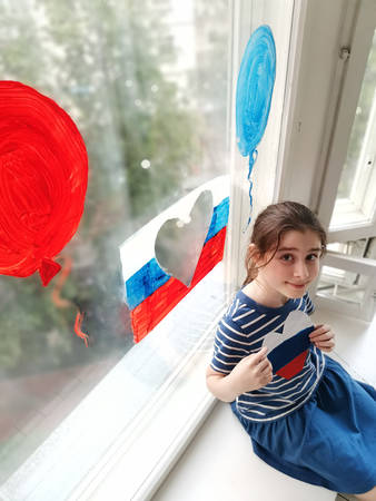 Windows of Russia action . country day June 12. girl drew a flag balloons heart.