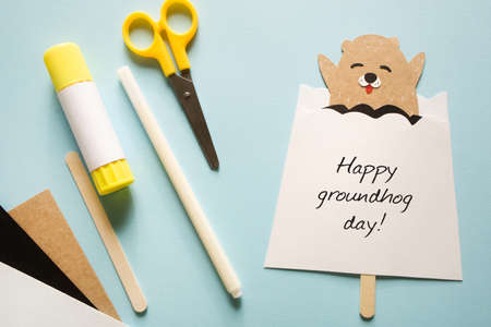 happy groundhog day. paper craft for kids. on blue background. create art for children