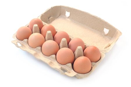 Ten Brown Eggs In A Carton Isolated On White Stock Photo