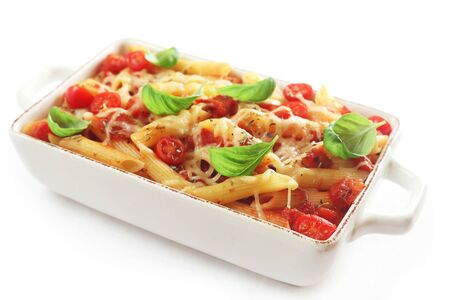 Pasta Gratin With Tomatoes And Basil Isolated On White Stock Photo