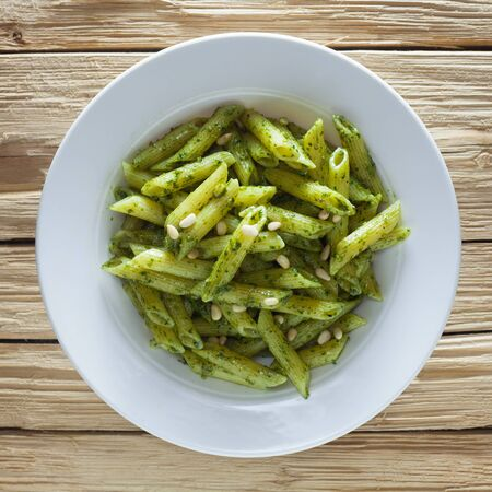 Pasta With Pesto Genovese On A Wooden Background