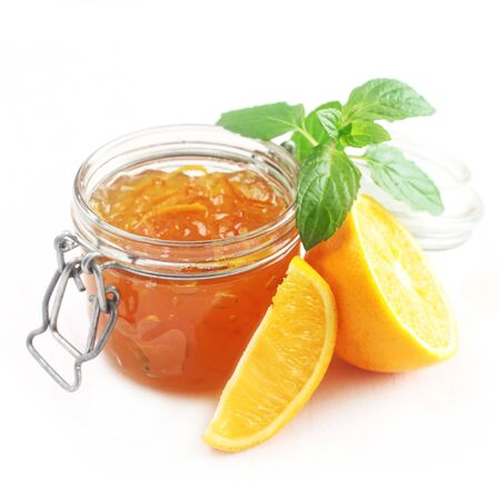 A Jar Of Orange Marmalade Isolated On White