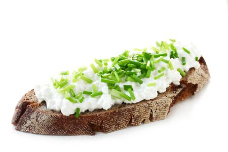 A Piece Of Bread With Cottage Cheese And Chives Isolated On White Archivio Fotografico