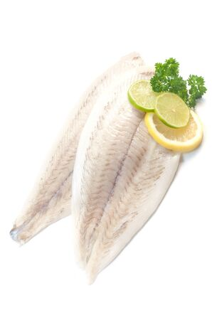 Two Raw Fillets Of Plaice Isolated On White