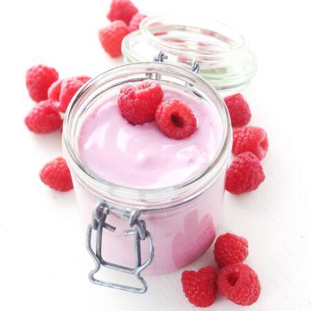 A Jar Of Raspberry Yogurt Isolated On White Reklamní fotografie