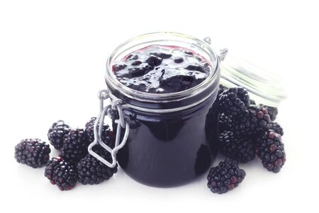 A Jar Of Blackberry Jam Isolated On White