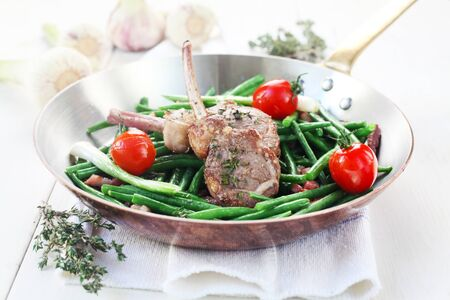 Lamb Chops With Green Beans And Tomatoes Served In A Pan