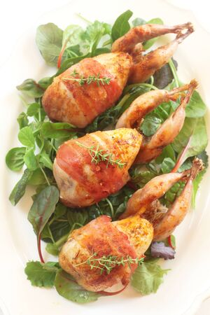 Three Roast Quails On Green Salad