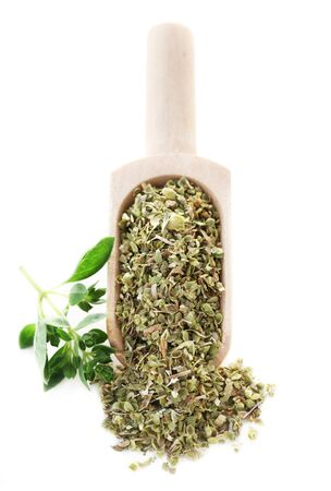 Dried Marjoram On A Wooden Shovel Isolated On White