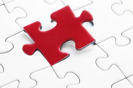 Red Piece In A White Jigsaw Puzzle