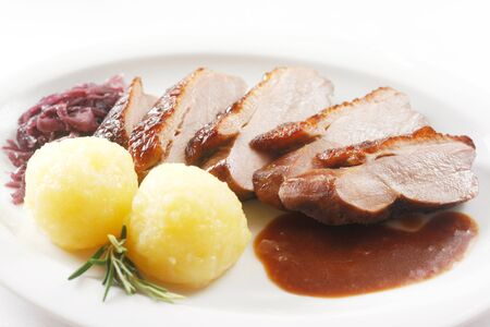 Roast Breast Of Duck With Red Cabbage And Dumplings