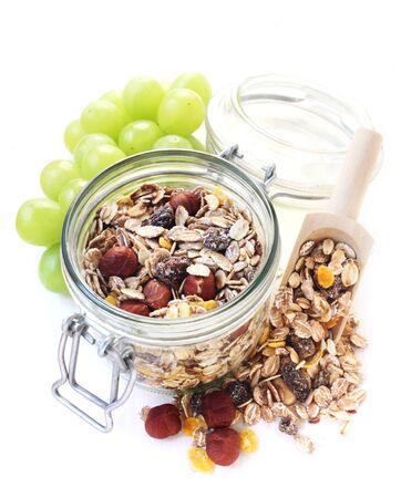 A Jar Of Fruit And Nut Muesli Isolated On White