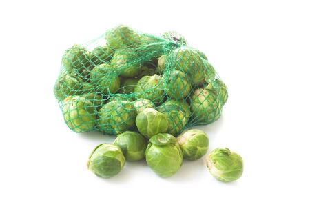 Brussels Sprouts In A Net Isolated On White