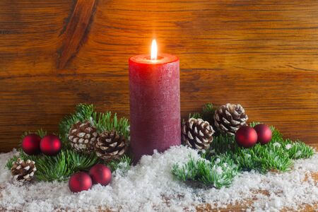Christmas Arrangement With A Red Candle