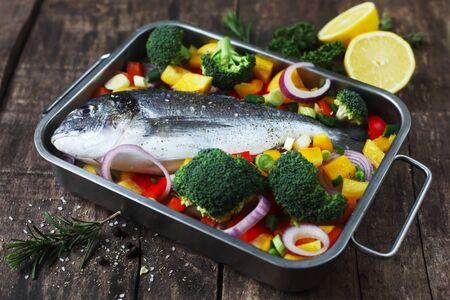 Raw Gilthead With Ingredients In An Oven Dish
