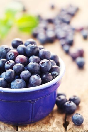 Blueberries In A Blue Bowl On A Wooden Background Stock fotó