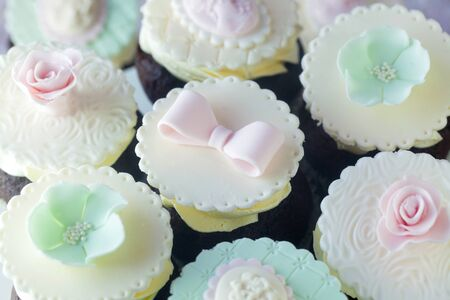 Dainty Cupcakes With Pink And Light Green Decorations