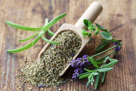 Herbs de Provence On A Wooden Background