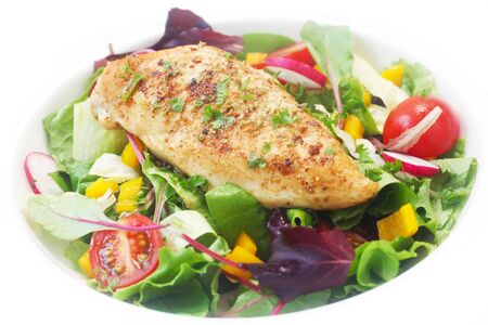 Mixed Salad With Fried Chicken Breast On A White Plate Foto de archivo - 135485091