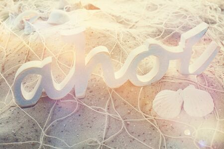 Ahoi Spelled In Wooden Letters On Beach Sand