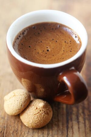Espresso In A Brown Cup On A Wooden Background