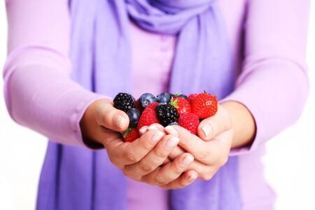 Female Hands Holding Mixed Berries