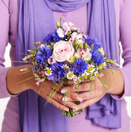 Female Hands Holding A Posy
