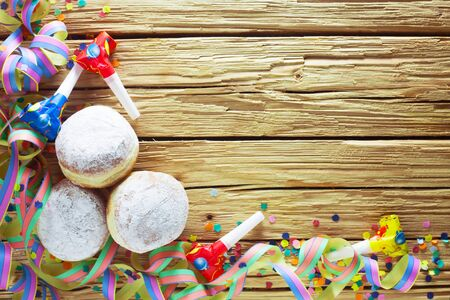 Background With Doughnuts And Party Streamers For Carnival