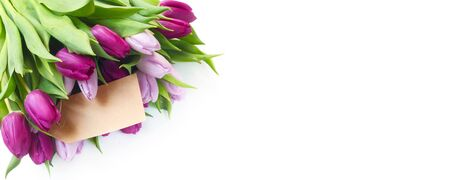 A Bunch Of Tulips With A Blank Paper Label Isolated On White