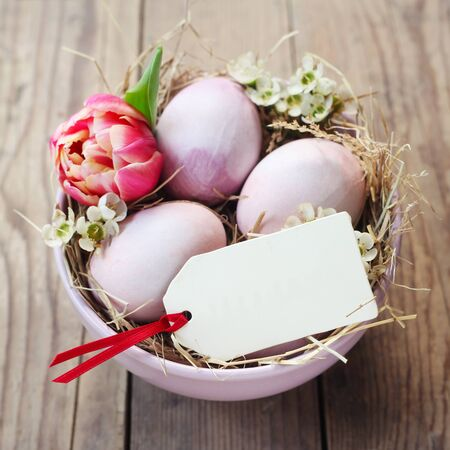 Easter Nest With A Blank Label On A Wooden Background
