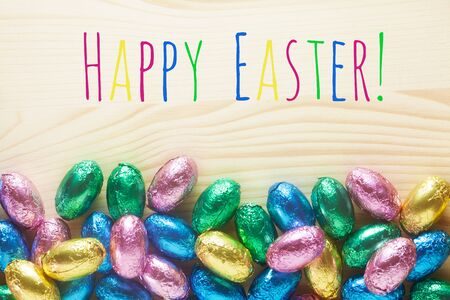 Happy Easter Message On A Wooden Background With Easter Eggs