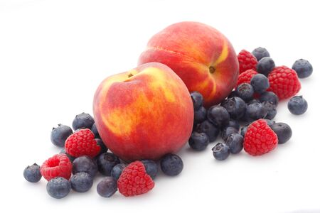 Peaches And Berries Isolated On White 版權商用圖片