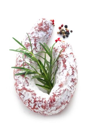 Salami With Rosemary And Peppercorns Isolated On White