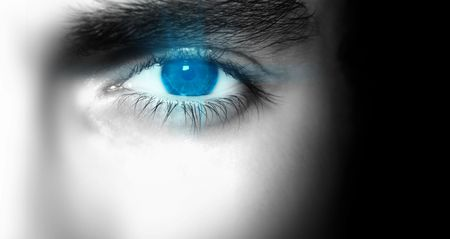 A close up of a mens eye.