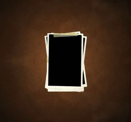 Picture Frames on leather background. photo