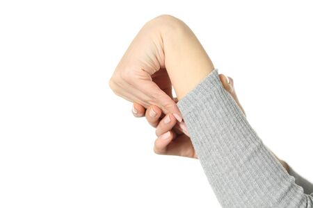 Close up of hypermobile woman hand bending wrist isolated on white background Stok Fotoğraf