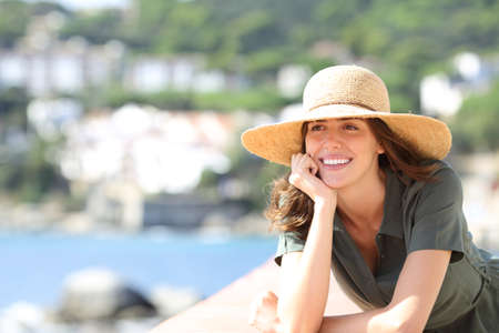 Happy woman with perfect smile on the beach on summer vacation Stok Fotoğraf