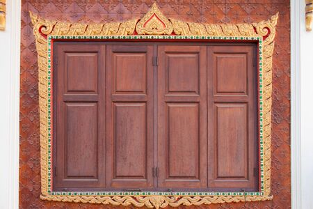tabernacle: Carved wooden window in thai temple