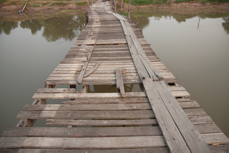 endangering: Old wooden bridge over canal Stock Photo
