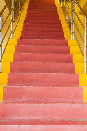 Red and yellow ladder at thai temple