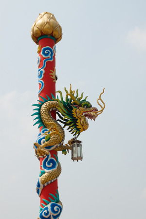 noxious: Dragon statue on pillar at chinese temple Stock Photo