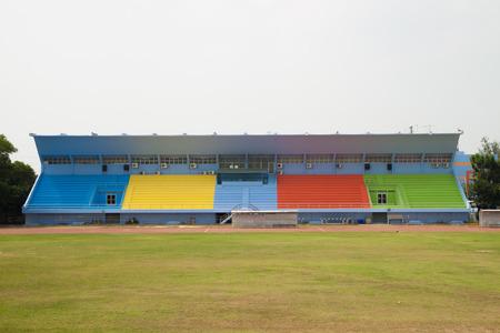exert: Colorful grandstand in football stadium