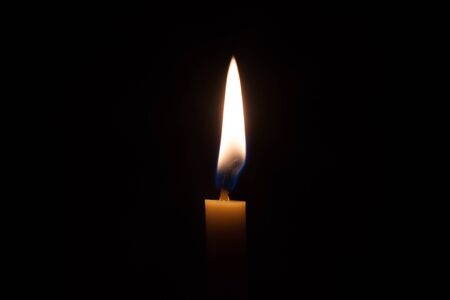 sombre: Fire and yellow candlelight in the dark room Stock Photo