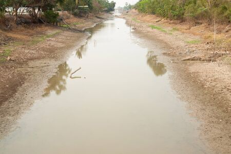 rainless: The remaining water in dried canal at thailand