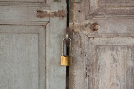 master key: The master key on the old door background Stock Photo