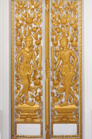 The golden carve door in thai temple
