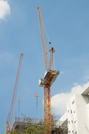 structuring: The big steel crane with the building constuction  Stock Photo
