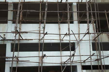 structuring: The wooden scaffold with the buiding under construction