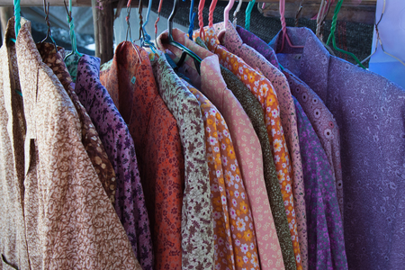 The colorful of clothes hang on the hanger Stock Photo