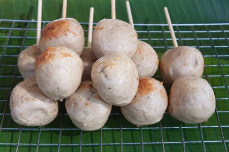 The background of toast meat ball with the wood stick